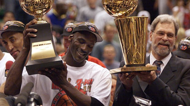 Michael Jordan celebrates with Phil Jackson after winning the 1998 NBA Finals