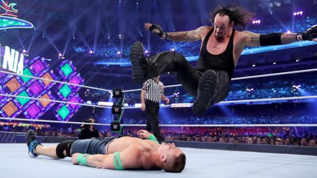 The Undertaker hits a leg drop on John Cena at WWE's WrestleMania 34