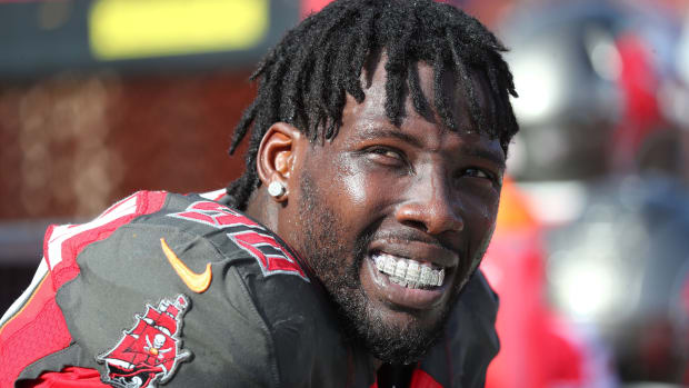 Dec 29, 2019; Tampa, Florida, USA; Tampa Bay Buccaneers linebacker Jason Pierre-Paul (90) looks on with his mouth grill against the Atlanta Falcons during the first half at Raymond James Stadium.