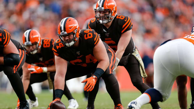Nov 3, 2019; Denver, CO, USA; Cleveland Browns quarterback Baker Mayfield (6) lines up behind center JC Tretter (64) in the third quarter against the Denver Broncos at Empower Field at Mile High. Mandatory Credit: Isaiah J. Downing-USA TODAY Sports