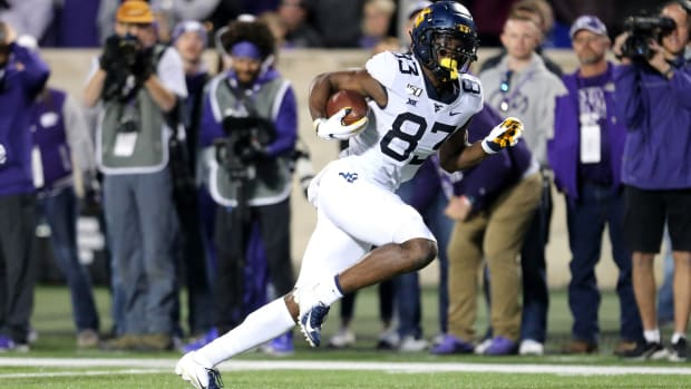 West Virginia Mountaineers wide receiver Bryce Wheaton (83) scores the game-winning touchdown in the fourth quarter of a game against the Kansas State Wildcats at Bill Snyder Family Stadium.