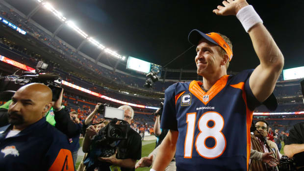 Denver Broncos quarterback Peyton Manning (18) waves to the crowd as he runs off the field after the game against the San Francisco 49ers at Sports Authority Field at Mile High.