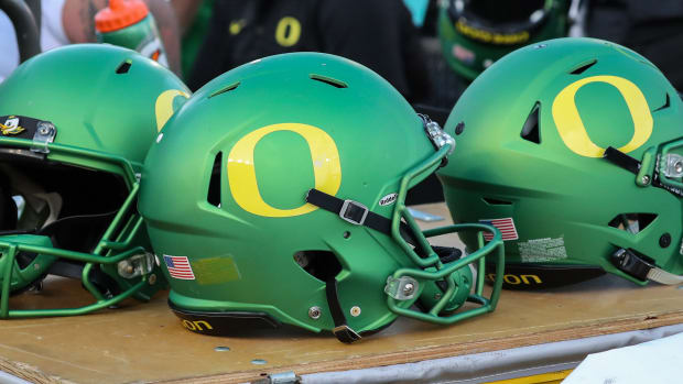 Former Oregon signee Luke Hill was arrested on eight charges in Maryland on Tuesday.
