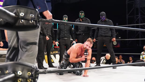 "AEW's Jon Moxley in the ring after being attacked by Brodie Lee's ""Dark Order"""