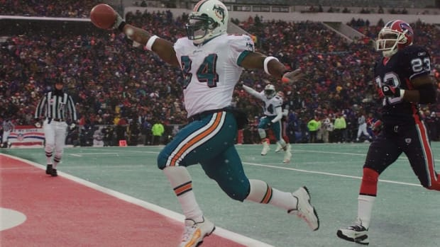 Ricky Williams set a Dolphins single-game record with 228 yards at Buffalo in 2002
