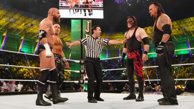 The Undertaker and Kane square off in the ring with Triple H and Shawn Michaels before their match at WWE Crown Jewel in 2018