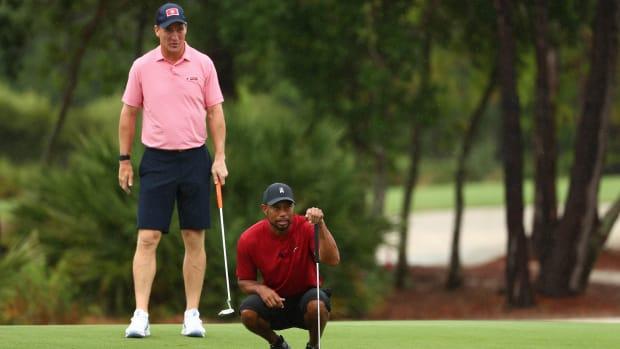 Tiger Woods Peyton Manning the match