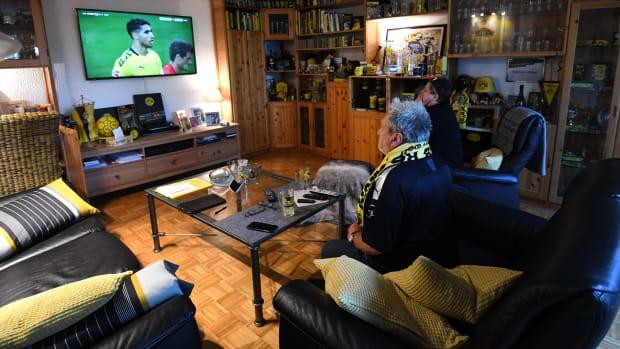 Borussia Dortmund fans watch their club play Bayern Munich