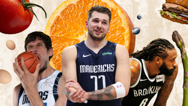 Boban Marjoanovic, Luka Doncic and DeAndre Jordan surrounded by food