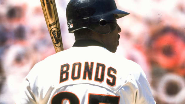 Barry Bonds holding a bat with his back to the camera