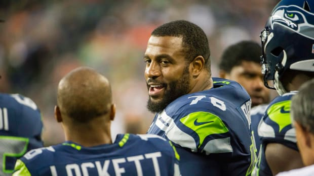 Seattle Seahawks offensive tackle Duane Brown (76) talks to wide receiver Tyler Lockett (16) during the first half against the Denver Broncos at CenturyLink Field.