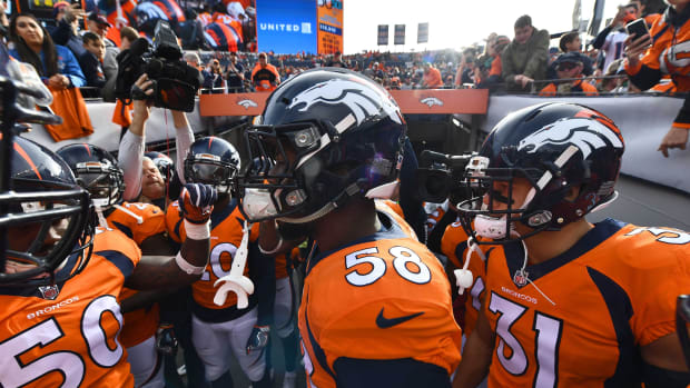Denver Broncos inside linebacker Zaire Anderson (50) and outside linebacker Von Miller (58) and strong safety Justin Simmons (31) huddle before the game against the Cincinnati Bengals at Sports Authority Field.