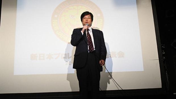 NJPW executive Takaaki Kidani speaks on stage