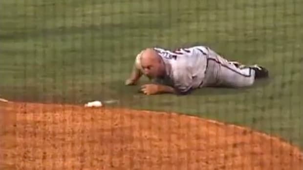 Manager Phillip Wellman crawls on the ground after being ejected from a baseball game in 2007