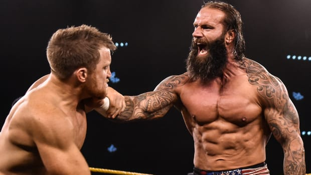 WWE's Jaxson Ryker chokes his opponent in the ring on NXT