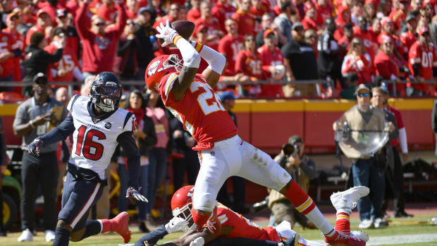 Oct 13, 2019; Kansas City, MO, USA; Kansas City Chiefs free safety Juan Thornhill (22) intercepts a pass intended for Houston Texans wide receiver Keke Coutee (16) during the first half at Arrowhead Stadium. Mandatory Credit: Denny Medley-USA TODAY Sports