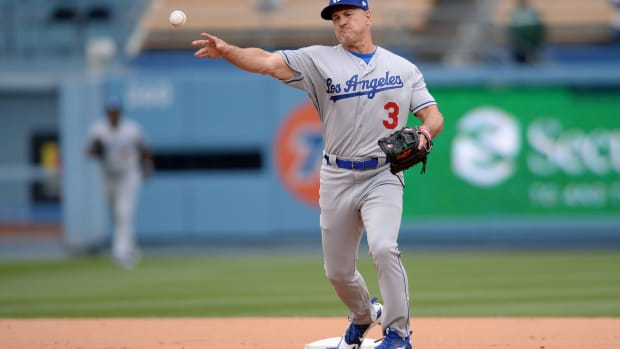 May 12, 2018; Los Angeles, CA, USA; Los Angeles Dodgers former player Steve Sax throws to first base during the Dodgers Alumni game before a game between the Dodgers and the Cincinnati Reds at Dodger Stadium. Mandatory Credit: Orlando Ramirez-USA TODAY Sports