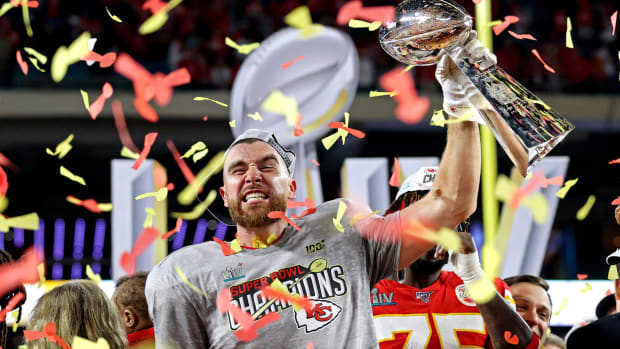 Feb 2, 2020; Miami Gardens, Florida, USA; Kansas City Chiefs tight end Travis Kelce (87) celebrates with the Vince Lombardi Trophy after beating the San Francisco 49ers in Super Bowl LIV at Hard Rock Stadium. Mandatory Credit: Matthew Emmons-USA TODAY Sports