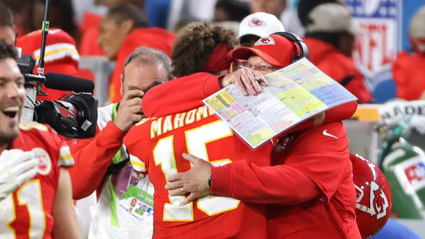 Feb 2, 2020; Miami Gardens, Florida, USA; Kansas City Chiefs quarterback Patrick Mahomes (15) hugs Chiefs head coach Andy Reid (R) on the sidelines against the San Francisco 49ers in the fourth quarter in Super Bowl LIV at Hard Rock Stadium. Mandatory Credit: Geoff Burke-USA TODAY Sports