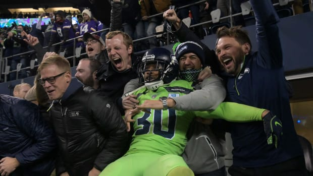 Bradley McDougald celebrates with the crowd at CenturyLink Field.