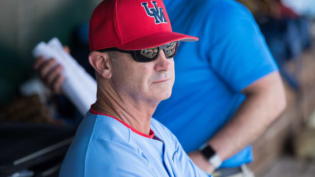 Mississippi Rebels head coach Mike Bianco looks on from the dugout during the game against the Arkansas Razorbacks at Baum-Walker Stadium. Mandatory Credit: Brett Rojo-USA TODAY Sports