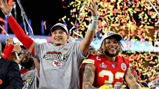 Feb 2, 2020; Miami Gardens, Florida, USA; Kansas City Chiefs quarterback Patrick Mahomes (15) and strong safety Tyrann Mathieu (32) celebrate after beating the San Francisco 49ers in Super Bowl LIV at Hard Rock Stadium. Mandatory Credit: Matthew Emmons-USA TODAY Sports
