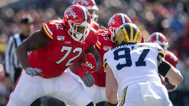 Nov 2, 2019; College Park, MD, USA; Maryland Terrapins offensive lineman Marcus Minor (72) and offensive lineman Austin Fontaine (55) block Michigan Wolverines defensive lineman Aidan Hutchinson (97) during the first half at Capital One Field at Maryland Stadium. Mandatory Credit: Tommy Gilligan-USA TODAY Sports