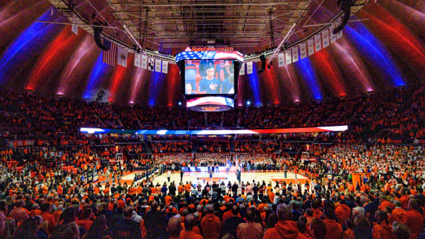 The national anthem is preformed prior to the first half before a game between the Illinois Fighting Illini and the Maryland Terrapins at State Farm Center.