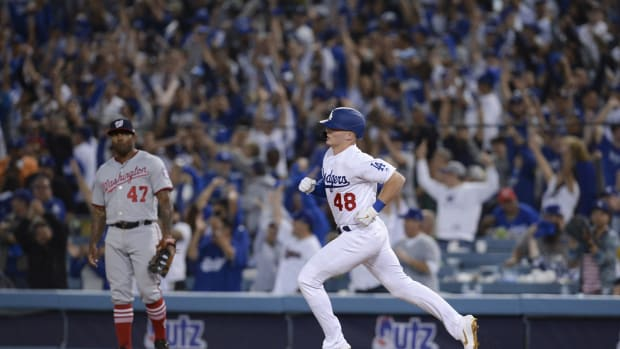 Oct 3, 2019; Los Angeles, CA, USA; Los Angeles Dodgers shortstop Gavin Lux (48) rounds the bases off a solo home run as Washington Nationals first baseman Howie Kendrick (47) looks on during the eighth inning in game one of the 2019 NLDS playoff baseball series at Dodger Stadium. Mandatory Credit: Gary A. Vasquez-USA TODAY Sports