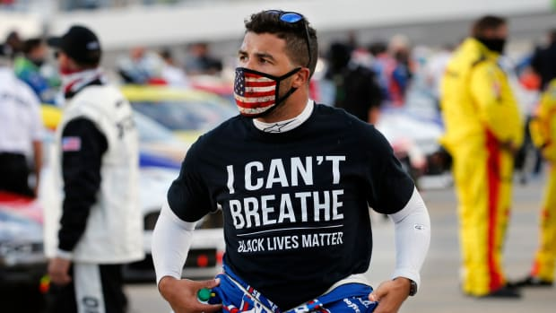 """NASCAR driver Bubba Wallace wears an """"I Can't Breathe"""" shirt before a race at Martinsville."""