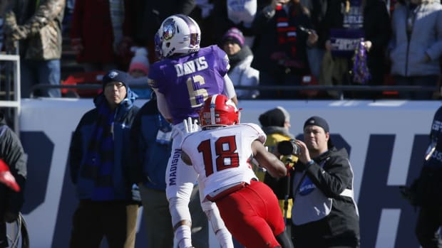 James Madison Dukes wide receiver Rashard Davis (6) catches a touchdown pass against Youngstown State Penguins cornerback D.J. Thomas (18) in the first quarter in the D1 college football championship game at Toyota Stadium.
