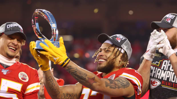 Jan 19, 2020; Kansas City, Missouri, USA; Kansas City Chiefs safety Tyrann Mathieu (32) celebrates with the Lamar Hunt Trophy after defeating the Tennessee Titans in the AFC Championship Game at Arrowhead Stadium. Mandatory Credit: Mark J. Rebilas-USA TODAY Sports