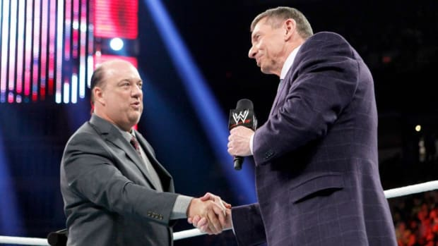 Paul Heyman and Vince McMahon shake hands in the ring on Raw
