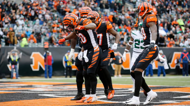 Cincinnati Bengals running back Joe Mixon (28) and the offense celebrate a touchdown in the second quarter of the NFL Week 13 game between the Cincinnati Bengals and the New York Jets at Paul Brown Stadium in downtown Cincinnati on Sunday, Dec. 1, 2019. The Bengals led 17-6 at halftime. New York Jets At Cincinnati Bengals