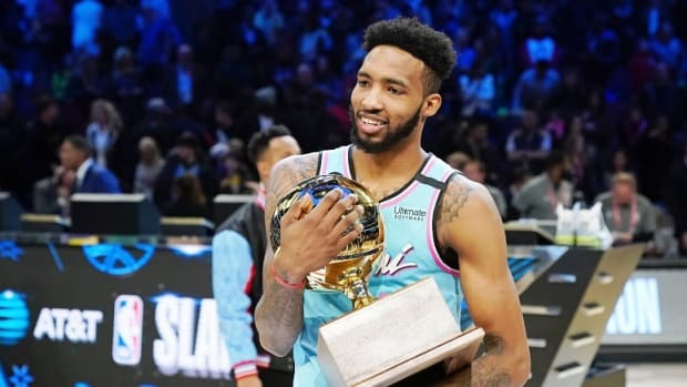 Miami Heat forward Derrick Jones, Jr. holds the trophy after winning the slam dunk contest during NBA All-Star Saturday Night at United Center.