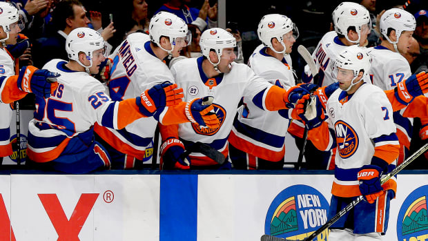 New York Islanders right wing Jordan Eberle (7) is congratulated after scoring a goal against the Detroit Red Wings during a February 2020 game at Nassau Veterans Memorial Coliseum.