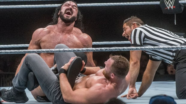 Dean Ambrose puts Drew McIntyre in a leg lock at Garret Coliseum in Montgomery on the Road to Wrestlemania in 2019.