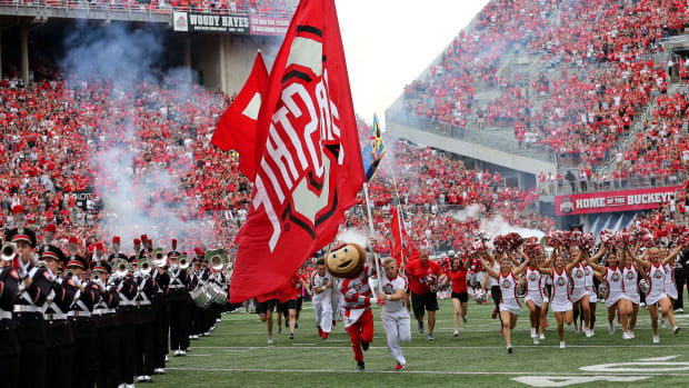 Brutus leads the Ohio State Buckeyes through the tunnel in front of a capacity crowd at Ohio Stadium