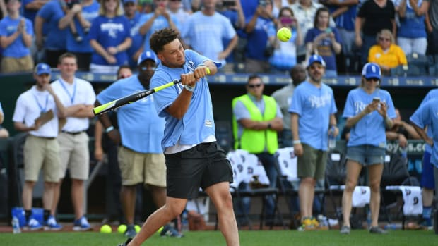 Jun 7, 2019; Kansas City, MO, USA; Kansas City Chiefs quarterback Patrick Mahomes hits a home run during the Big Slick celebrity softball game at Kauffman Stadium. Mandatory Credit: Denny Medley-USA TODAY Sports