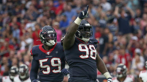 Oct 6, 2019; Houston, TX, USA; Houston Texans defensive end D.J. Reader (98) celebrates after making a tackle during the third quarter against the Atlanta Falcons at NRG Stadium. Mandatory Credit: Troy Taormina-USA TODAY Sports