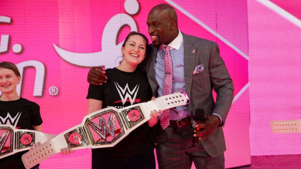 WWE's Titus O'Neil poses with a fan