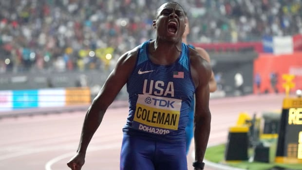 Christian Coleman celebrates after winning the 100m in 9.76 during the IAAF World Athletics Championships at Khalifa International Stadium.