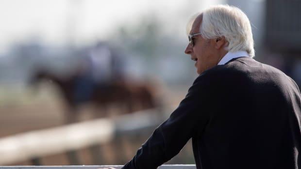 Bob Baffert looks on the edge of a horsetrack