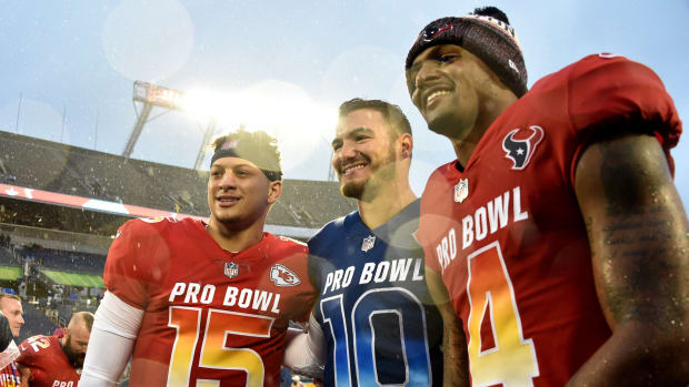 Jan 27, 2019; Orlando, FL, USA; AFC quarterback Patrick Mahomes of the Kansas City Chiefs (left) NFC quarterback Mitchell Trubisky of the Chicago Bears (center) and AFC quarterback Deshaun Watson of the Houston Texans (right) all pose for a picture after their game in the NFL Pro Bowl football game at Camping World Stadium. Mandatory Credit: Steve Mitchell-USA TODAY Sports