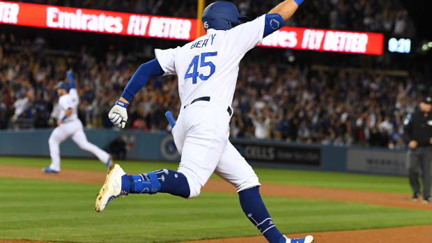Jun 21, 2019; Los Angeles, CA, USA; Los Angeles Dodgers first baseman Matt Beaty (45) rounds the bases after hitting a walk off two run home run scoring second baseman Max Muncy (13) to defeat the Colorado Rockies 4-2 in the ninth inning at Dodger Stadium. Mandatory Credit: Jayne Kamin-Oncea-USA TODAY Sports