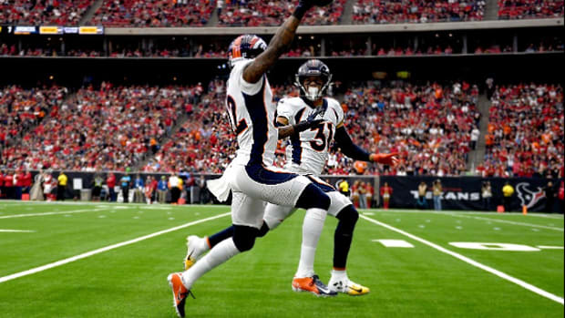 Denver Broncos strong safety Kareem Jackson #22 heads down the field with free safety Justin Simmons #31 on a 70 yard interception return for a touchdown to make the score 13-0 in the first quarter as the Broncos take on the Texans at NRG Stadium in Houston, Texas on December 8, 2019.