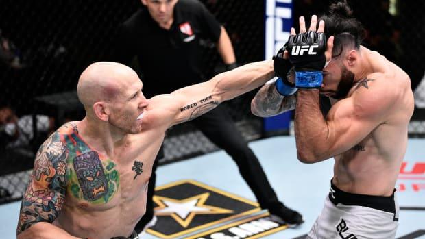 Josh Emmett punches Shane Burgos at UFC Fight Night