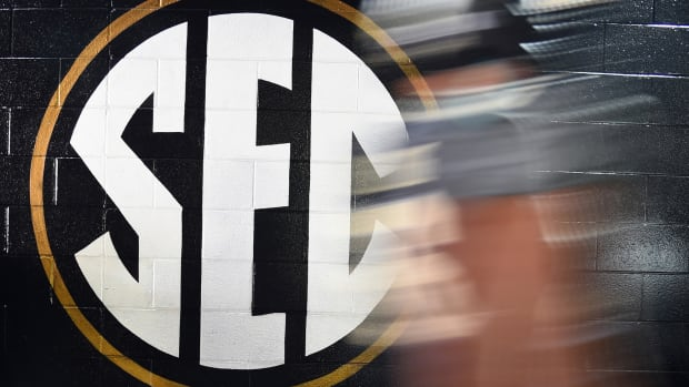 General view of an SEC logo as a Vanderbilt Commodores player walks to the locker room before the game against the Missouri Tigers at Vanderbilt Stadium. Mandatory Credit: Christopher Hanewinckel-USA TODAY Sports