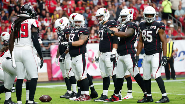 Arizona Cardinals offensive linemen line up against the Atlanta Falcons during the second quarter.