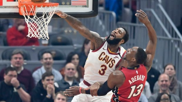 Cleveland Cavaliers center Andre Drummond misses a dunk beside Miami Heat forward Bam Adebayo in the first quarter at Rocket Mortgage FieldHouse.